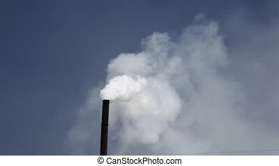 Factory chimney blowing co2 into atmosphere