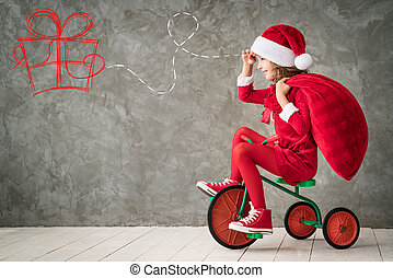 Christmas Xmas Winter Holiday Concept - Happy child rides a...