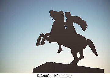 Silhouette of Alexander the Great Statue at sunset....