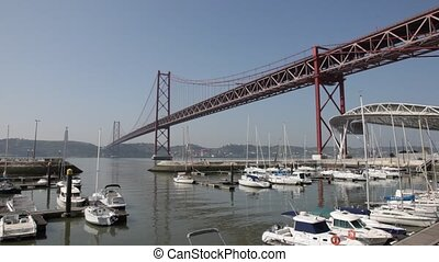 Bridge and Marina in Lisbon - Suspension bridge Ponte 25 de...