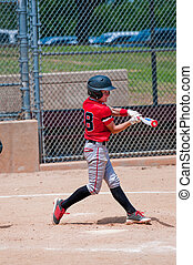American teen baseball player swinging the bat. - Youth...