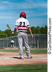 American baseball player up at bat - Teen baseball boy...