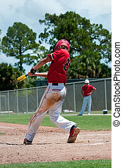 American baseball player swinging bat - Teen baseball boy...