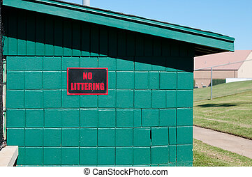 No littering sign on baseball dugout