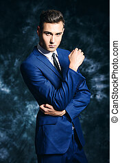 respectable style - Fashion shot of a handsome young man in...