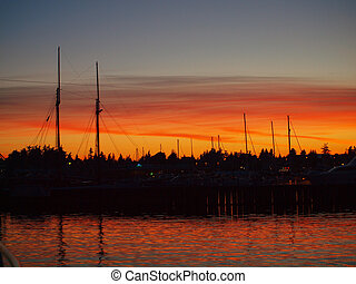 Fishing Boats at a Dock with a Beautiful Sunset