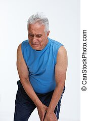 Knee pain. - Elderly man having knee pain isolated white...