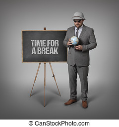 Time for a break text on blackboard with businessman and...