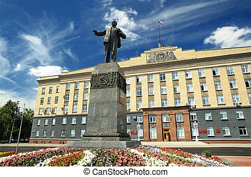 Lenin monument and city administration building in sunny day...