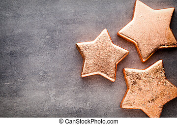Bronze star. Christmas pattern. Background on the gray...