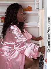 Obese black woman get to fridge for late snack - Overweight...