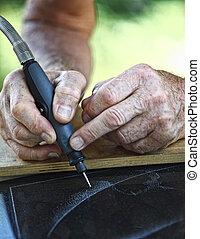 craftman at work detail - detail of craftman during make...