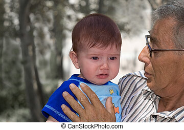 Why are you upset? - Crying baby with his gradpa