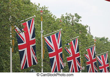 Many defocussed Union Jack flags background copy space -...