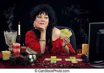 Gipsy witch holds fortune telling cards - Portrait of mature...