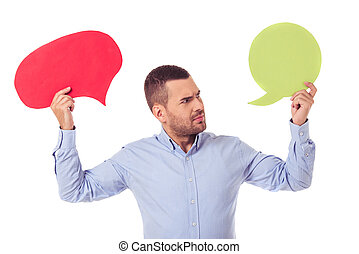 Businessman with speech bubbles - Handsome businessman in...