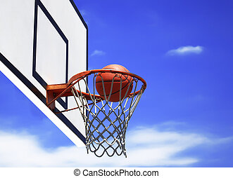 Basketball - Photo of basketball hoop and blue sky in...