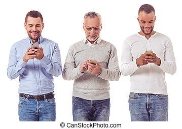 Three businessmen with gadgets - Three handsome businessmen...