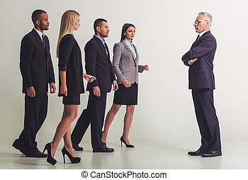 Beautiful business team - Full length portrait of mature...