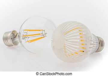 two LED bulbs with different cover, plastic and glass