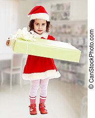 Little girl in costume of Santa Claus with gift - Cute...