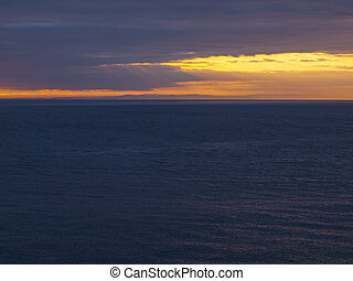 Beautiful Sunset Overlooking the Ocean from a Cliffside