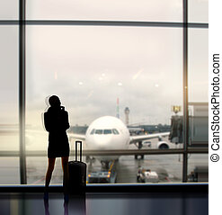 businesswoman expects fligh - silhouette of businesswoman...