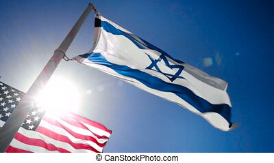 Flags of Israel and USA - Israel and USA flags fluttering in...