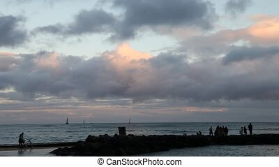 Surf paddling Hawaii - twilight at Waikiki beach. Waikiki...