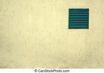 Old ventilation grille with bars on a grungy building, white...