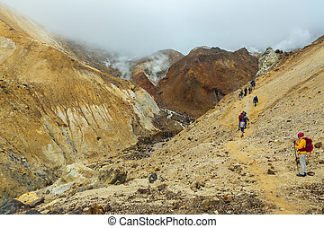 Climbing to active volcano Mutnovsky on Kamchatka. -...