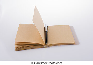 Pen on a notebook on a white background