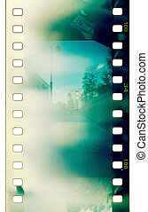 film background - grunge film strip with light leaks