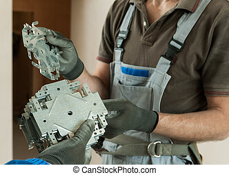 Worker gets the items for assembling metal frame