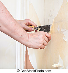 Scrape the backing off the wall - repairing of apartment,...
