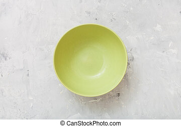 top view of green bowl on concrete plate - top view of green...