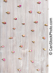 natural pink rose flower buds on wooden surface