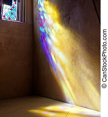 Sunrays of coloured light on wall - Stained Glass window...
