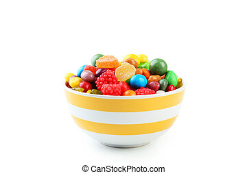 Colorful candies in bowl on white background