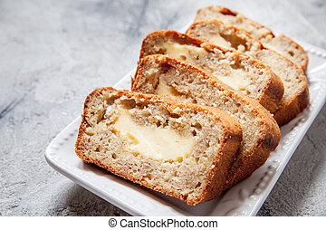 Sliced banana bread with cream cheese - Sliced cream cheese...