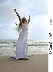 Bride With Arms up at the Beach