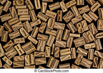 letters and numbers - background of randomly placed wooden...