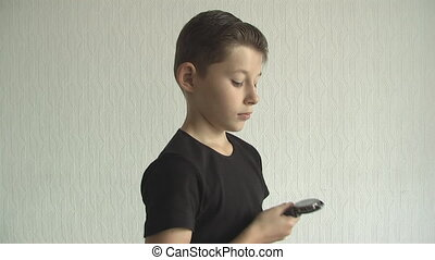 Young boy checking his watch for the time