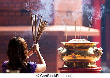 woman holding incense sticks - woman holding smoking big...