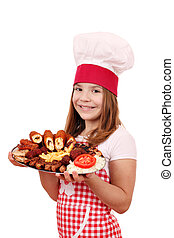 happy little girl cook with grilled meat