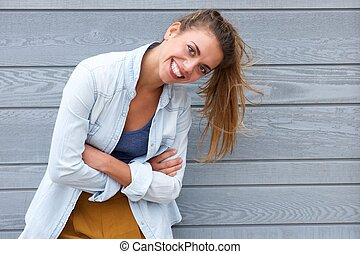 Confident woman smiling with arms crossed - Portrait of...