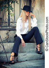 Sexy and beautiful young woman in man suit. Fashion look and make up.