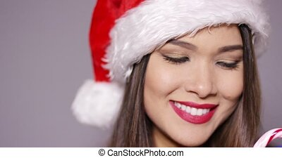 Sensual young woman biting a candy cane - Sensual young...