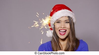 Gorgeous sexy young woman in a Santa hat - Gorgeous sexy...