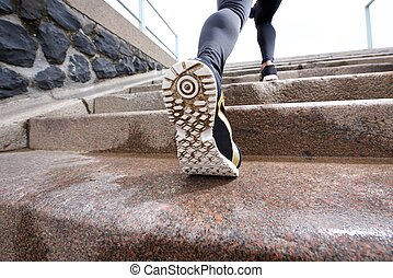 Female runner in action on staircase